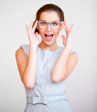 Young attractive business woman with glasses