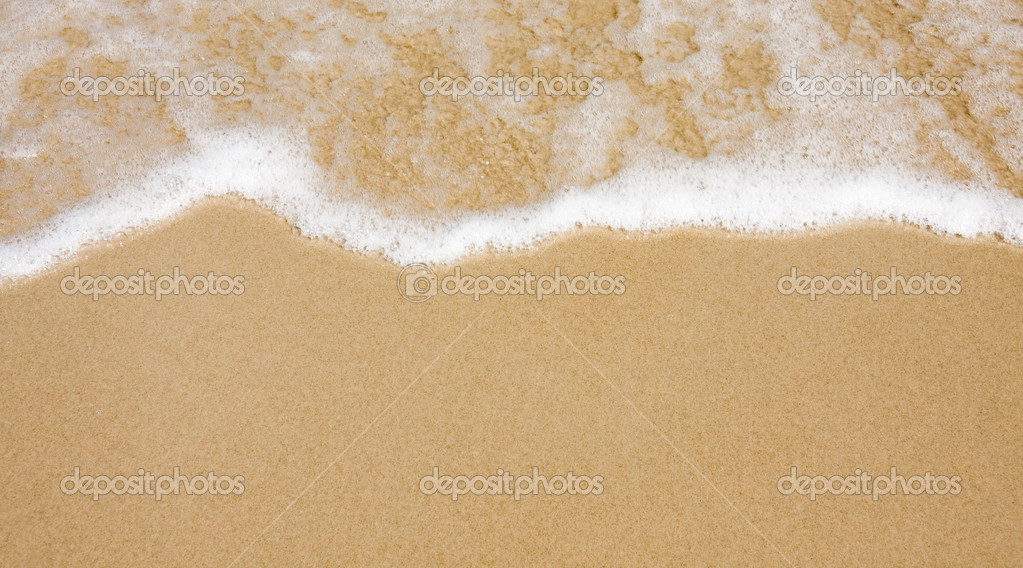 Wave on clear sand beach