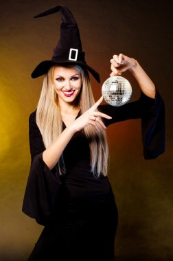 Witch with a disco ball