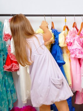 Little girl in shop of dresses