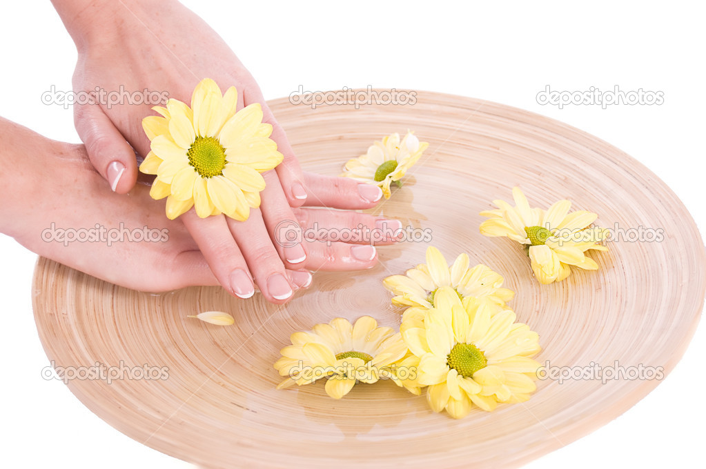 Woman hands and flowers