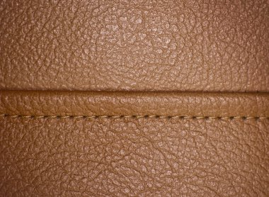 Horizontal stitched leather background.