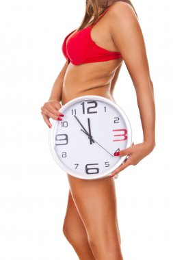 Naked woman with clock