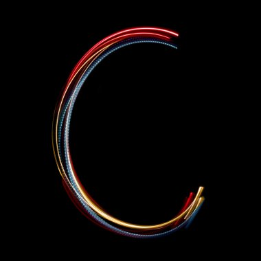 Letter C made from brightly coloured neon lights