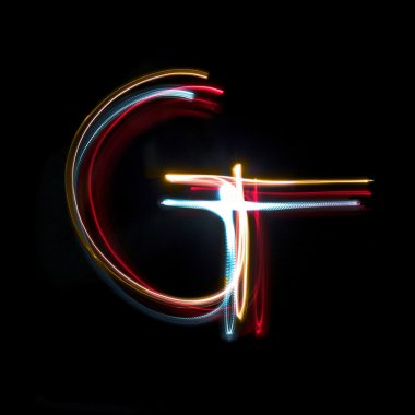 Letter G made from brightly coloured neon lights