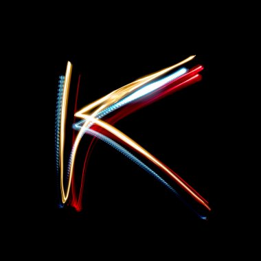 Letter K made from brightly coloured neon lights