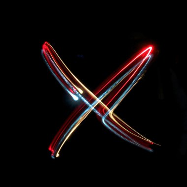 Letter X made from brightly coloured neon lights