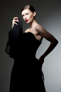 Young woman in black dress