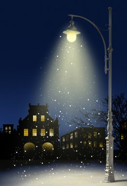 Snow falls in the city at night
