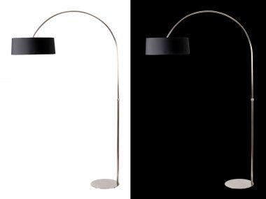 Modern black floor lamp isolated over white and black background
