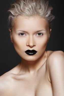 Woman model with fashion make-up, gloos black lips, white eyeshadows