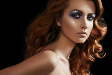 Fashion woman model with glitter evening make-up, shiny long curly hair