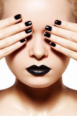 High fashion style, manicure, cosmetics and make-up. Dark lips make-up