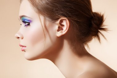 Beautiful profile view of female model face with bright fashion make-up