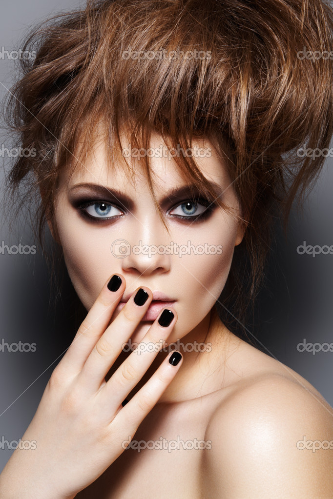 Fashion model with tousled hair, make-up, manicure. Fashion portrait