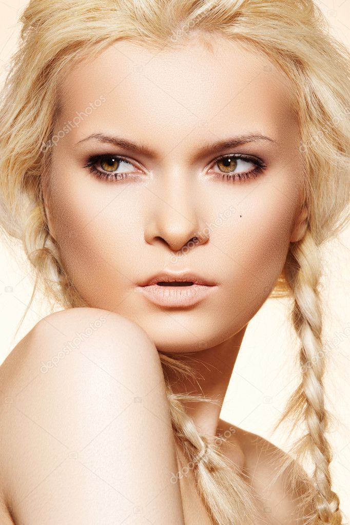 Attractive blond woman model with fashion hairstyle with braids