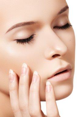 Make-up & cosmetics, manicure. Close-up portrait of beautiful face