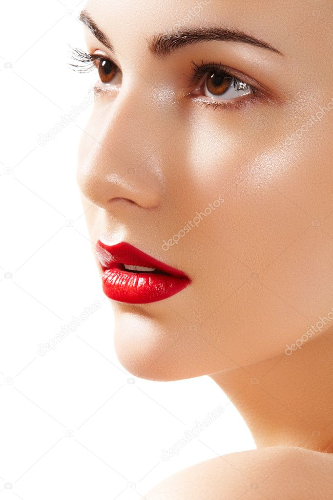Close-up portrait of beautiful woman. Purity face with bright red lips