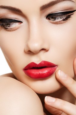 Close-up portrait of sexy caucasian young woman model with glamour red lips