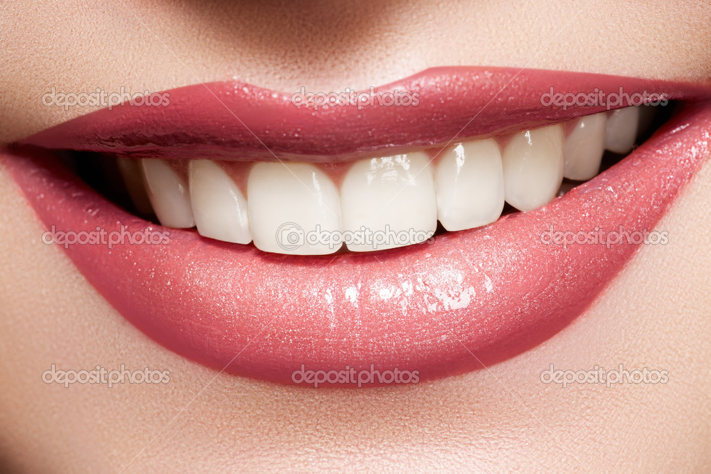 Close-up happy female smile with healthy white teeth, bright gloss lips