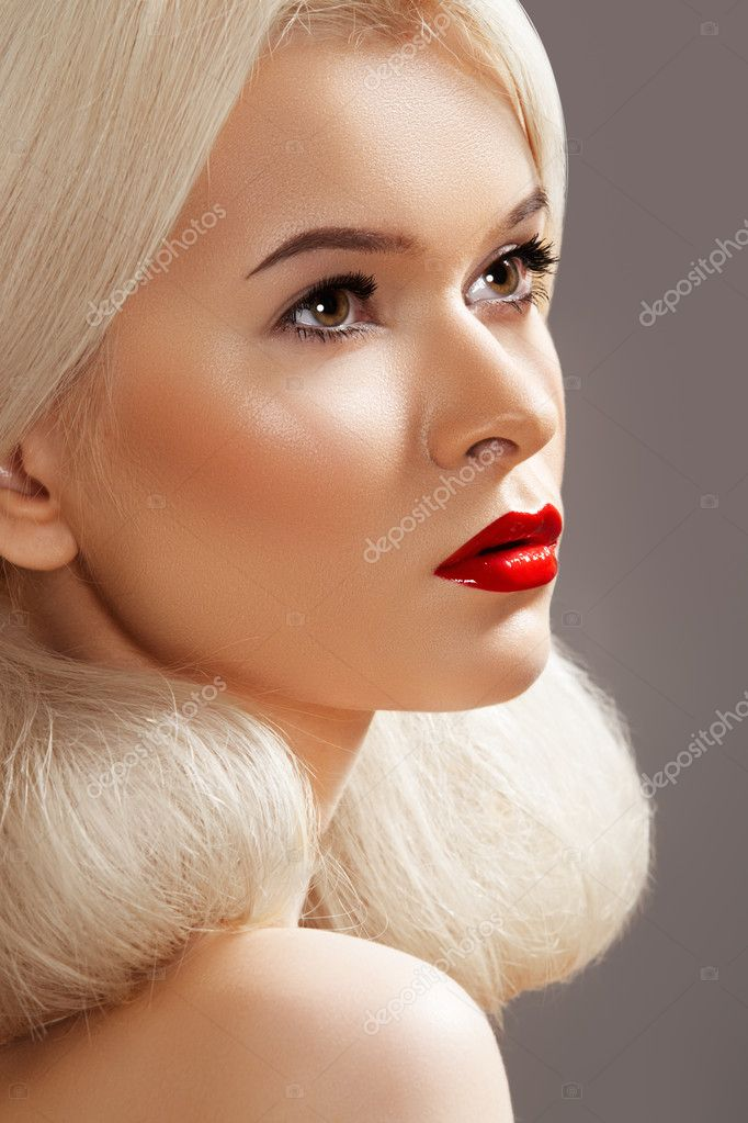 Doll style. Sensual woman model with fashion bright red lips make-up