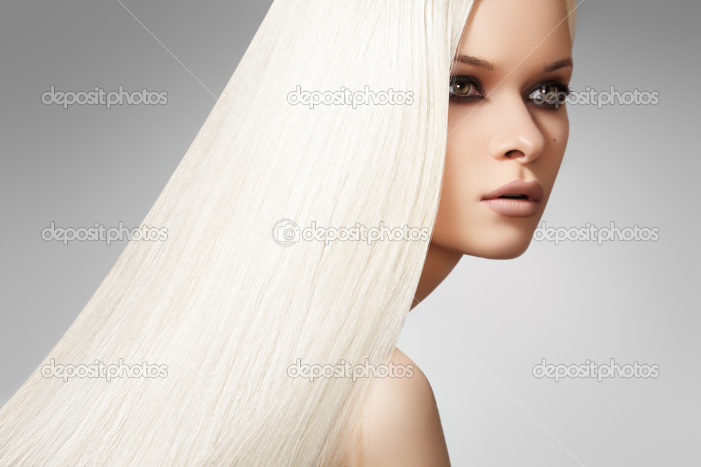 Sensual woman model with shiny straight long blond hair