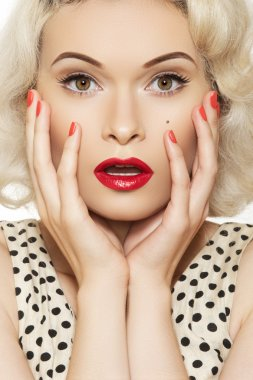 Portrait of beautiful young sexy woman with vintage make-up and hairstyle