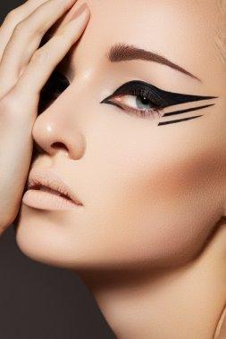 Stock Photo: Glamourous closeup female portrait. Fashion eyeliner make-up