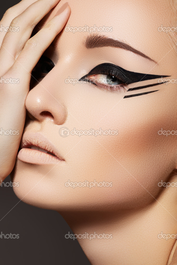 Stock Photo: Glamourous closeup female portrait. Fashion eyeliner make-up