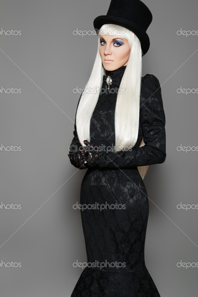 Chic aristocratic woman in retro style black dress and beaver hat