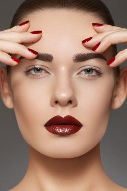 Luxury fashion style, manicure, cosmetics and make-up. Dark lips make-up