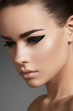 Glamourous closeup female portrait. Fashion evening elegance eyeliner