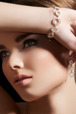 Beautiful woman model in retro style make-up. Accessories, jewelry
