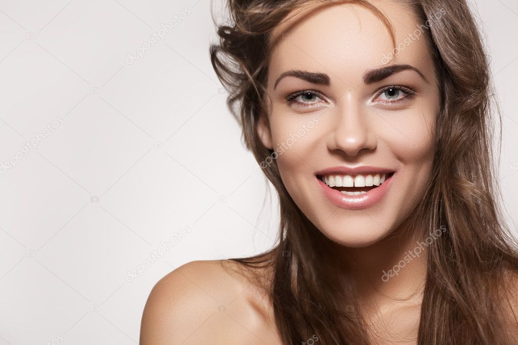 Happy beautiful young woman model with natural daily makeup. Lovely female