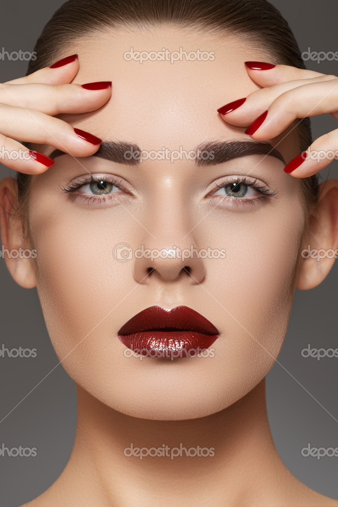 Luxury fashion style, manicure, cosmetics and make-up. Dark lips make-up