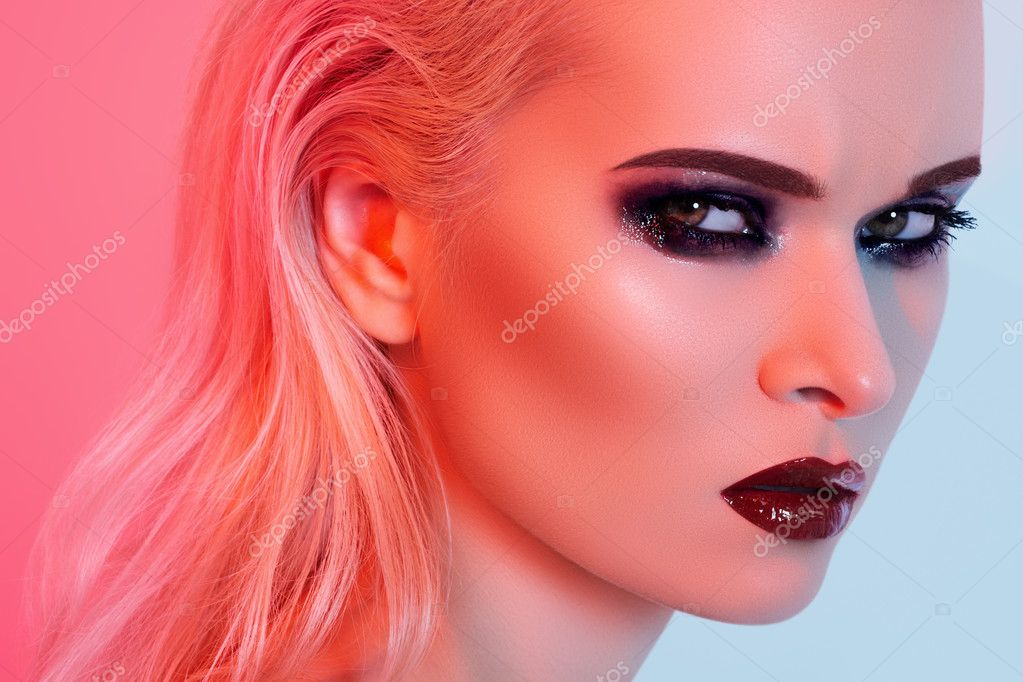 Punk rock style or halloween make-up. Fashion woman model face