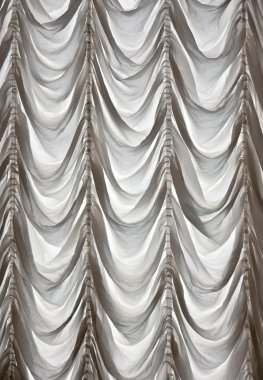 White curtains draped theater