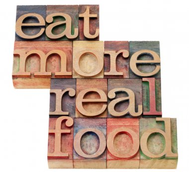 Eat more real food - healthy lifestyle concept - isolated text in vintage wood letterpress printing blocks stock vector