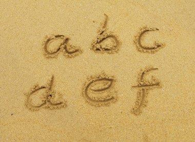 Alphabet letters, handwritten in sand on beach stock vector