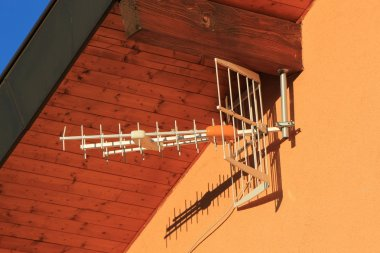 Antenna on house wall