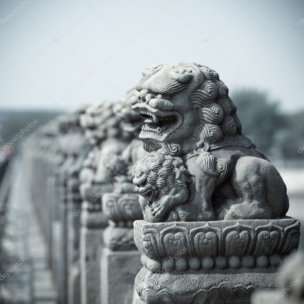 Ancient vivid stone lion on the bridge in beijing,China