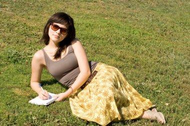 Girl sitting on grass in park