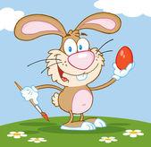 Hnědá Velikonoční zajíček malovat vajíčka venku