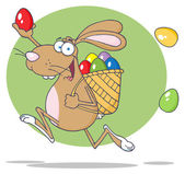 Fotografie Happy Brown Bunny Participating In An Easter Egg Hunt