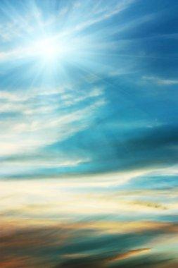 Sky blue background with wispy clouds