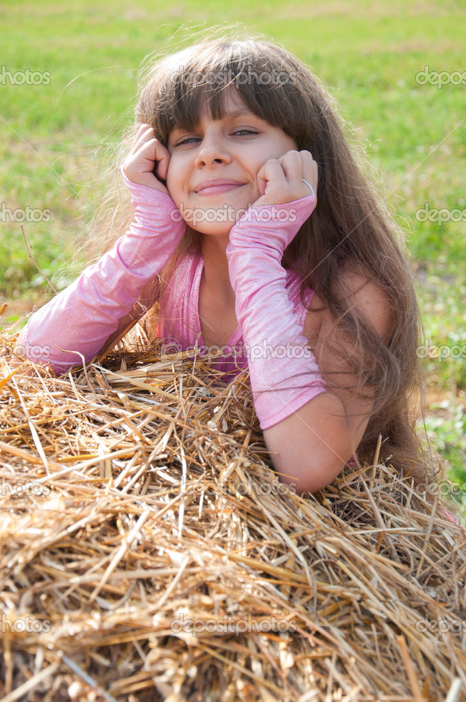 A beautiful dark-haired girl in a field