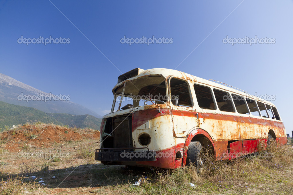 Bus wreck in arid landscape