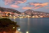 Fotografie City of Saranda in Albania at sunset