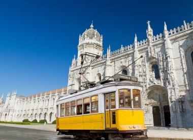 Yellow tram of Lisbon at Jeronimos monastery, Portugal
