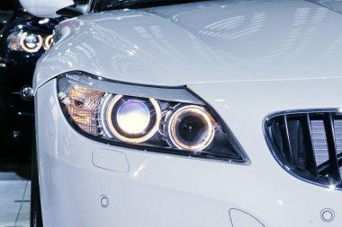 Modern headligts of white car